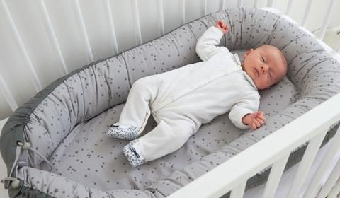 Rappel d'un réducteur de lit bébé de la marque Tinéo