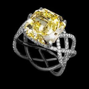 Bague de fiançailles or blanc et diamants jaune Lorenz Bäumer