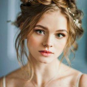 Coiffure de mariage tresse couronne et fleurs