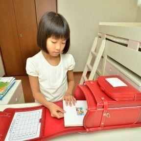 Sensibiliser son enfant au poids de son cartable de manière ludique
