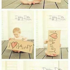 Photo de bébé avec pancarte i love daddy
